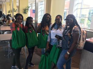 Students pose with care packages provided by the Alpha Kappa Alpha Lambda Phi alumnae chapter at the Black Student Union's Black Student Orientation event on Friday, September 8.
